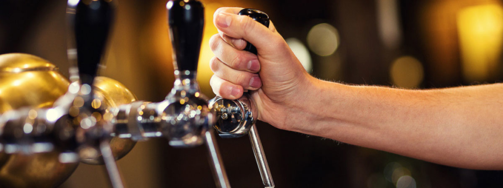 Person pulling a pint