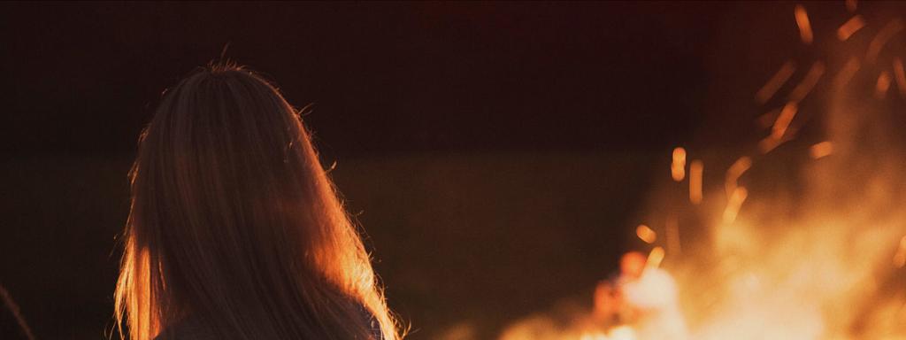 Women in front of bonfire
